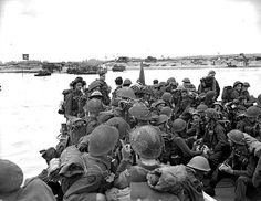 """Personnel of Royal Canadian Navy Beach Commando """"W"""" landing on Mike Beach Juno sector of the Normandy beachhead. June 6th 1944. Most are wearing Mk III helmets. From the National Archives of Canada."""