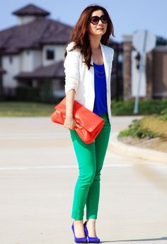 green-jeans-with-cobalt-blue-shoes-and-top-with-white-blazer-and-red-bag