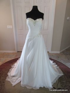 Description Gorgeous chiffon a-line wedding dress with a sparkly sweetheart neckline and beaded accent at the site hip. The bodice features an ultra flattering asymmetrical ruching of chiffon that flo