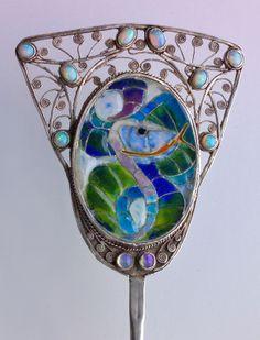 FREDERICK JAMES PARTRIDGE 1877-1942 Guild of Handicraft Serpent Hair Pin  Silver Plique-à-jour enamel Opal H: 22 cm (8.66 in)  W: 6.5 cm (2.56 in)  British, c.1900