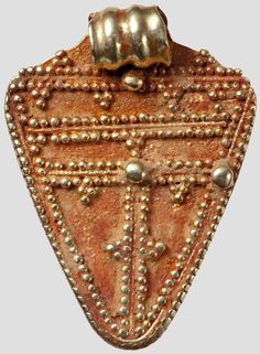 Gold pendant with Granulation, Germanic, 5th - 6th century.  Square pendant with rounded corners and geometric decoration of fine granules - double lines and triplets. In single large granules. The upper corner turns into a profiled, rolled to an eyelet metal strips.