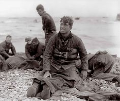 U.S. Army soldiers recovering the remains of comrades at Omaha Beach in a photograph by Walter Rosenblum (June 6, 1944)
