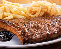 Try our famous ribs or one of the many items off our sizzling grill menu. Served with Spur-style crispy onion rings and chips OR a baked potato. Pork Spare Ribs, Crispy Onions, Grills, Baked Potato, Steak, Bbq, Chips, Menu, Food