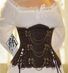 Saw thos Corset on a women at a fair and looks really great in pwrson. Steampunk Brown Brocade And Chains Underbust Corset Costume Steampunk, Mode Steampunk, Steampunk Pirate, Steampunk Wedding, Victorian Steampunk, Steampunk Clothing, Renaissance Clothing, Gypsy Clothing, Steampunk Corset Dress
