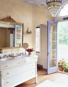 Repurposed dresser as vanity in this vintage inspired bathroom. love the colors, the painted ceiling and the chandelier!