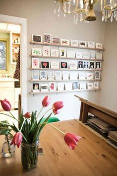 Ways to hang photos - use shelving to lean pictures against the wall