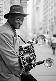 New York People. 72 year old photographer Louis Mendes. Since the he has been photographing people in public places with his 1959 Graflex Speed Graphic.