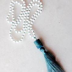 Turquoise tassel necklace with white onyx & blue agate