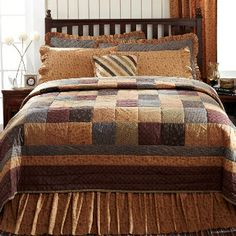 Lewiston Country Bedding has warm shades of brown, cream, tan, burgundy, grey and blue. Country look with a whole quilt of small prints. Love it!!!