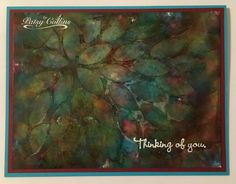 """By Patsy Collins. Apply alcohol inks to felt on applicator tool. Tap on glossy cardstock to cover. Lay flower stencil on piece. With foam on applicator tool, pick up blending solution from craft mat. Tap through stencil; wait to dry; repeat. Lift stencil. Stamp sentiment from """"Friend to Friend"""" set (Stampin' Up) in VersaMark; heat emboss with white powder. Technique by Tim Holtz: https://www.youtube.com/watch?v=DNTsSiTCHaI"""