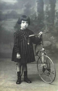 Vintage Spanish photo of a gorgeous young girl and her bicycle