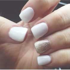 Gorgeous white nails with gold glitter on the ring finger Prom?!