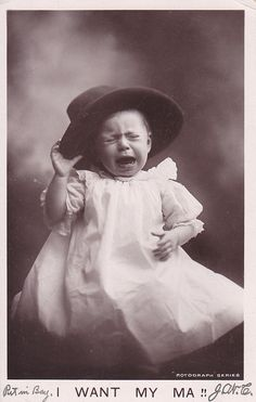 Unhappy baby in Daddy's hat.......early 1900's