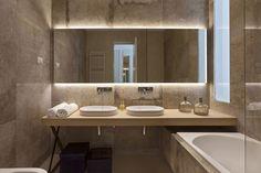 Modern bathroom with unique sink 'table,' back-lit mirror, tuck under tub Bathroom Design Decor, House, Bathroom Interior Design, Modern Mirror Wall, Lighted Bathroom Mirror, Modern Bathtub, Contemporary Bathrooms, Luxury House, Luxury Bathroom