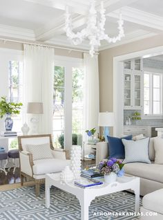 Haynes chose breezy sheers by Fabricut and a cast-resin fixture by Oly to add lightness
