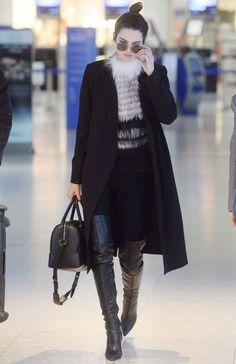 Arriving at London Heathrow airport.   - ELLE.com
