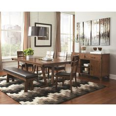 Give your room a complete makeover with this Williamsburg 6-piece dining set. The dark amber and coffee bean wood finish has a modern but classy design accented with unique features a hand-stitching pattern. Complete the look with an optional server.