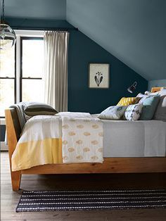 Decorating ideas for designing a beautiful bedroom with sloped ceilings. Sloped ceiling bedroom design ideas for storage, decorating, and space utilization. Rooms With Slanted Ceilings, Slanted Ceiling Bedroom, Slanted Walls, Attic Bedroom Ideas Angled Ceilings, High Ceilings, Blue Master Bedroom, Upstairs Bedroom, Bedroom Wall, Bedroom Decor