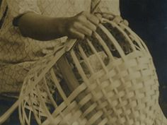 In the Appalachians, both before and during the Craft Revival, baskets were made from a variety of materials.  By far the most common material for non-Cherokee baskets was white oak.  These baskets were made from a young oak sapling that was split laterally again and again to form long, supple splits or splints.  Woven over a framework of ribs, split oak baskets were sturdy.