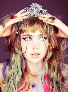 Get a peek inside Grimes' makeup bag, in the Feb/Mar '13 issue of BUST Magazine
