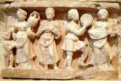 Rammetromme. Frame-drum Indo-Greek Banquet. Hellenistic banquet scene, Hadda, Gandhara. 1st century CE. Musee Guimet Paris. - Pinterest