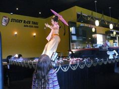 Apinya performing a Thai Dance called the Umbrella Dance at the Sticky Rice Thai Cuisine Restaurant