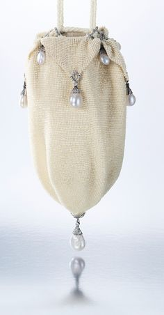 RARE AND UNUSUAL NATURAL PEARL, SEED PEARL AND DIAMOND EVENING BAG, CIRCA 1923, VAN CLEEF & ARPELS