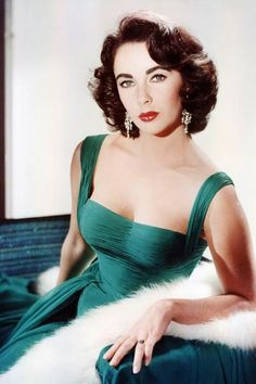 The Elizabeth Taylor Look Book, circa 1950 - classic dress, classic pose - amazing woman.