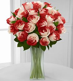 "Red & White ""Rainbow Roses"" from FTD. Gift these in a silver paint can with red paint drips down the sides, then decorate with heart charms and/or playing cards. Or put them in a whimsical black-and white checked/striped teapot. (For Alice in Wonderland fans, of course!)"