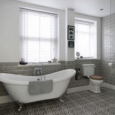 Bathroom with roll-top bath and patterned floor tiles Bathroom Floor Tiles, Modern Bathroom, Small Bathroom, Master Bathroom, Tile Floor, Bathroom Ideas, Bathroom Vinyl, Bathroom Grey, Downstairs Bathroom