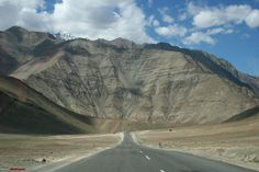 Known as the MAGNETIC HILL, this place is located 30 km from the leh town in the Indian state of Jammu and Kashmir. In this region you can experience for yourself vehicles moving up at a speed of 20 kmph with engines off!! And the explanation given for the same is OPTICAL ILLUSION!! It's a place where the layout of the surroundings create an optical illusion, therby making a slight downhill look like an uphill slope.