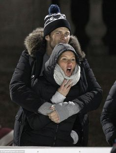 Quality time: Following their first public sighting together since the New England Patriots failed to qualify for the huge event, Tom Brady was seen cosying up to his wife Gisele at their son's hockey game