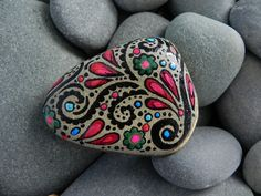 Hand painted one of kind stones.  So pretty!