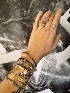 finger tattoo + eclectic mix of jewels