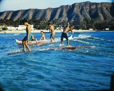 Children surf in Hawaii, 1959.  (Ralph Crane—The LIFE Picture Collection/Getty Images)