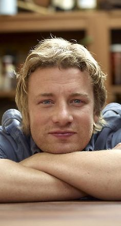 Jamie Oliver. I just love him.. He seems like a nice guy.. VERY funny. Simple. Down to earth...and he has made me smile sooooo many times. That alone is a reason to love him <3