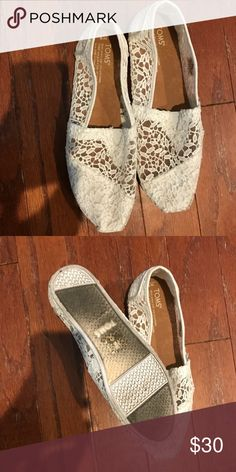 White lace toms- women's size 9 Great condition- worn once on my wedding night! They make great dancing shoes for a wedding! Toms Shoes Flats & Loafers
