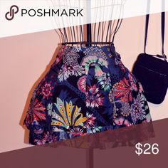 Multi-Colored Anthropologie Mini-Skirt This is the perfect skirt for hitting the town. Would look amazing with teal colored tights and black flats :) 72% cotton and 26% silk Leifsdottier Skirts Mini