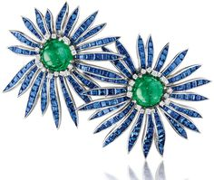 Verdura cabochon emerald, sapphire, diamond and platinum 'Double Aster' brooch, 1956. Via The Jewellery Editor.
