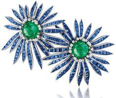 Verdura cabochon emerald, sapphire, diamond and platinum 'Double Aster' brooch, 1956. Via The Jewellery Editor.