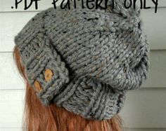 Bulky knit hat with buttons.