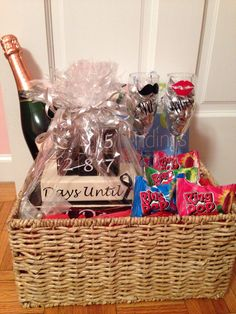 engagement gift basket: champagne glasses, countdown to wedding day blocks, wedding books/magazines, champagne, hershey kisses, and ring pops | easily customizable for different couples | made by me: instagram @ nicandri