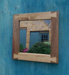 handmade square wall mirror with contrasting wood tone feature in chunky eco…