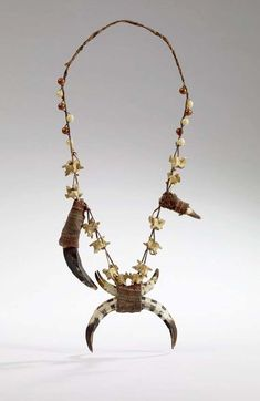Philippines ~ Mindanao Island | Hunter's necklace from the Bagobo, Yao people | Animal tusks, snake vertebrae, glass beads, silver and fiber