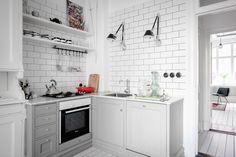 Cute little light grey kitchen in Scandinavian apartment