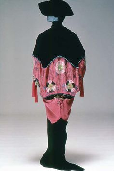 This is an example of a hobble skirt, which Poiret made very popular. These were so tight around the legs that women literally had to hobble to walk. This particular hobble skirt was made by Paquin.