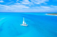 Discover the incredible turquoise water, beaches, and reef of the Turks and Caicos on an unforgettable and elegant sailing tour. Snorkel the reefs, visit secluded beaches, or watch the sunset! Sailing Charters, The Turk, Secluded Beach, Turquoise Water, Turks And Caicos, Oceans, Vacation Ideas, Beaches, Islands