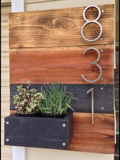 Custom made wooden planter with address numbers. Choice of vertical or horizontal numbers depending on how many. Reclaimed wood. Modern style raw metal