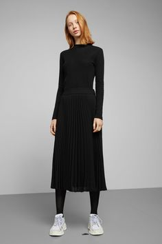 02bc62d7184cd The Valentin Pleated Skirt charms with its feminine silhouette and pleated  structure. cut in a