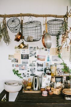 pinner: A boho kitchen vignette | Hanging wire basket and pictures collaged on the wall | Woodnote photography  me : I like the branch used to hang things